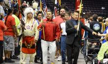 Grand Chief Stewart Phillip of Penticton reaches out to an audience member during the grand entry of the delegates to the 2014 BC Elders Gathering at the South Okanagan Events Centre. — Image Credit: Penticton Western News File Photo