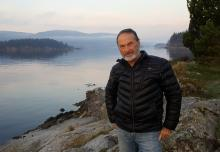 A smile in the face of reality. UBC ecological economist William E. Rees, co-creator of the ecological footprint concept, has some bad news for techno-optimists. Photo on Salt Spring Island provided by W. Rees.