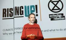 Roger Hallam, co-founder of Extinction Rebellion, speaking at a Rising Up conference. Photograph: David Levene for the Guardian