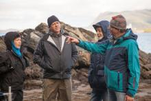 Dimitry Lisitsyn (R in black and teal coat) visiting Lelu Island. Photo courtesy of Skeena Wild Conservation Trust
