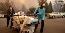 Patients were quickly evacuated from Feather River Hospital as it burned during the Camp Fire in Paradise, California, on Nov. 8, 2018. (Josh Edelson/AFP via Getty Images)