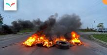 Tire fire - Failed arrest attempt leads to police retreat, barricades of burning tires - Christopher Curtis