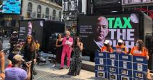 """Demonstrators gathered in Times Square in New York City on July 27, 2021 to participate in a """"Tax the Rich Game Show"""" and demand higher taxes on big corporations and wealthy people. (Photo: Tax March)"""