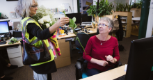 Members of XR deliver flowers, possibly reminiscent of a funeral bouquet, to Greenpeace staffers. (Photo: Courtesy of Jonny Pickup on Flickr.)