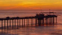 Scripps Pier after sunset in La Jolla, California. Image via Hayne Palmour IV/San Diego Union-Tribune/Los Angeles Times.
