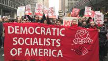 Democratic Socialists of America marching with banner