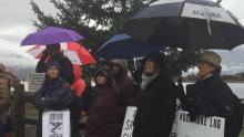 Protesters gathered in the rain in Squamish, B.C., Sunday to protest the planned Woodfibre LNG project. (Deborah Goble/CBC)