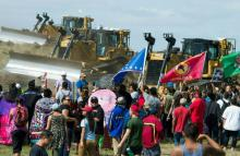 Members of the Standing Rock Sioux tribe and their supporters opposed to the Dakota Access Pipeline protesting at the site of construction near Cannon Ball, North Dakota, U.S., on September 3. Photo:Robyn Beck/AFP