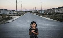 A portrait of a young girl on the streets of Easterville, Manitoba. Easterville is the reserve community of the Chemawawin Cree Nation, founded in 1962 after they were forcibly relocated during the construction of the Grand Rapids dam which flooded 202,343 hectares of land. Photo: Aaron Vincent Elkaim / The Narwhal