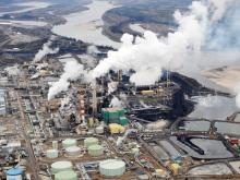 Aerial view of the Suncor oil sands extraction facility near the town of Fort McMurray. Some governments are proposing to ask oil companies to pay them for the cost of climate change damage caused by their products.