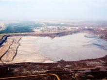 An oilsands tailings pond. JEFF MCINTOSH / THE CANADIAN PRESS