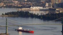 An oil tanker leaves Vancouver Harbour under the Lion's Gate bridge. File photo by Jonathan Hayward, Canadian Press