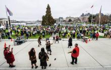 Protesters at the legislature grounds watch the Esquimalt Singers and Dancers perform Saturday at The Last Stand, a rally against logging of old-growth forests. DARREN STONE, TIMES COLONIST