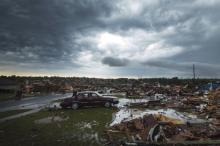 The clouds of a thunderstorm roll over neighborhoods heavily damaged in a tornado in Moore, Okla., May 23, 2013. (Credit: Reuters/Lucas Jackson)
