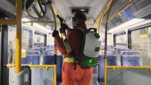 TransLink crews spray a bus with disinfectant. The transit authority says buses are now getting a weekly spray, along with regular cleaning. . TransLink