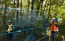 """Tree sitters aiming to block the Trans Mountain pipeline route in a Burnaby forest say they are """"under siege"""" after contractors erected blue fencing around their protest site on Tuesday.@Honu139/Twitter"""