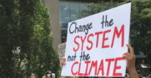Change the system not the climate - sign