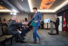 Prime Minister Justin Trudeau and B.C. Premier John Horgan shake hands as LNG Canada CEO Andy Calitz, back right, watches during a news conference in October 2018.Photo by Darryl Dyck, the Canadian Press