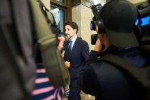 Prime Minister Justin Trudeau enters the House of Commons from a hallway in West Block on Feb. 18, 2020. Photo by Kamara Morozuk