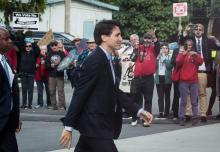 Protesters opposed to the Kinder Morgan Trans Mountain pipeline expansion shout at Prime Minister Justin Trudeau as he arrives for a discussion with the Indigenous Advisory and Monitoring Committee, on the Cheam First Nation near Chilliwack, B.C., on Tuesday.  (DARRYL DYCK / THE CANADIAN PRESS)