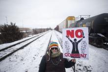 A protester holds a placard as supporters of the Wet'suwet'en hereditary chiefs demonstrate at Macmillan Yard in Toronto, on Feb. 15, 2020.  CHRIS YOUNG/THE CANADIAN PRESS