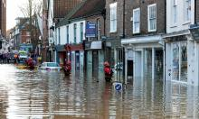 Rescue workers in York, where 3,500 homes remained at risk of flooding on Sunday. Photograph: Anna Gowthorpe/PA