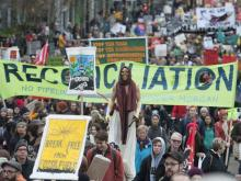 An estimated 5000 people march down Cambie Street from Vancouver city hall to downtown Vancouver Saturday, November 19, 2016 protesting the proposed expansion of the Kinder Morgan Trans Mountain pipeline. JASON PAYNE / PNG