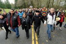 JENNIFER GAUTHIER/METRO FILE  Grand Chief Stewart Phillip, the head of the Union of B.C. Indian Chiefs, led protesters down a muddy trail deep into the conservation area's forest on Nov. 27, 2014, where Kinder Morgan continued work at a second injunction-protected site. Phillip, his mother and several others then crossed the police tape into the work area and were arrested by RCMP, joining more than 100 others who have been willingly arrested since police began enforcing the injunction.