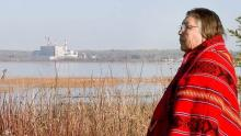 Elder Violet Poitras on the Paul First Nation. The TransAlta generating station sits in the background. Photo: Native Counselling Services of Alberta.