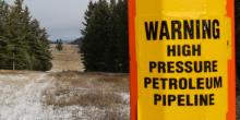 CHRIS HELGREN/REUTERS A sign warning of the subterranean presence of Kinder Morgan's Trans Mountain Pipeline in seen in ranchland outside Kamloops, B.C. on Nov. 16, 2016.