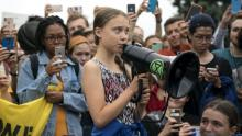 WASHINGTON, DC - SEPTEMBER 13: Teenage Swedish climate activist Greta Thunberg delivers brief remarks surrounded by other student environmental advocates during a strike to demand action be taken on climate change outside the White House on September 13, 2019 in Washington, DC. The strike is part of Thunberg's six day visit to Washington ahead of the Global Climate Strike scheduled for September 20. (Photo by Sarah Silbiger/Getty Images) , Photographer: Sarah Silbiger/Getty Images North America
