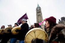 Protesters voice opposition to pipelines during a rally on Parliament Hill in Ottawa on Jan. 8. Dozens of rallies are planned in British Columbia, across Canada and as far away as Europe to support pipeline protesters arrested in northwestern British Columbia. (Sean Kilpatrick/Canadian Press/AP)